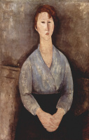 Seated woman in a white blouse