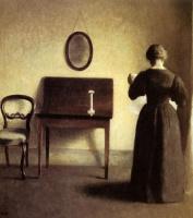Вильгельм Хаммерсхёй. Интерьер с женщиной, читающей газету