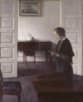 Вильгельм Хаммерсхёй. Интерьер с читающей женщиной