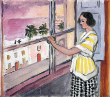The young woman at the window. Sunset