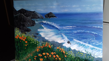 Sea landscape with orange flowers