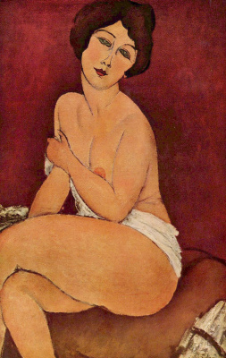 Amedeo Modigliani. Nude seated on a sofa