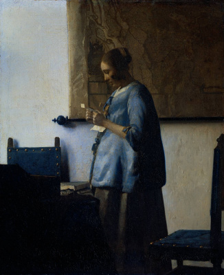 Jan Vermeer. Woman in blue reading a letter