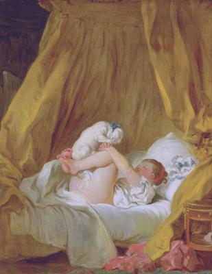 Девочка в постели, играющая с собачкой