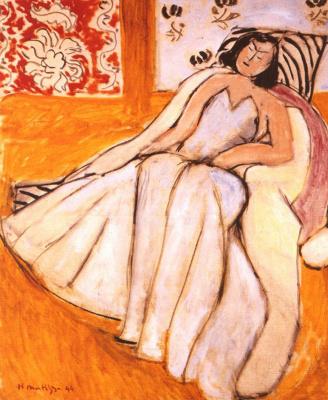 Анри Матисс. Женщина в кресле на охристом фоне