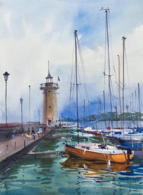 Andrew. Lighthouse on Lake Garda. Italy