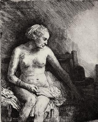 Rembrandt Harmenszoon van Rijn. Nude lying beside hat