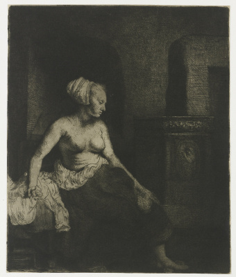 Rembrandt Harmenszoon van Rijn. Semi-Nude at the stove