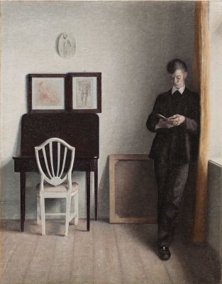 Vilhelm Hammershøi. Interior with a reading young man