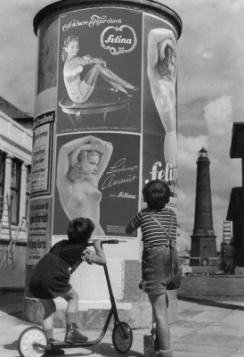 Historical photos. Children view lingerie ads