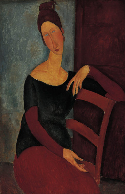 Amedeo Modigliani. Portrait of Jeanne hébuterne, putting his hand on the back of a chair