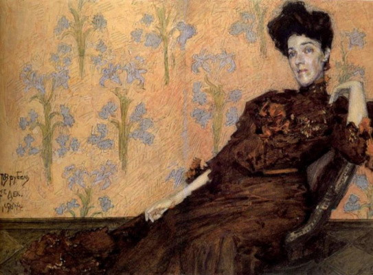 Mikhail Vrubel. Portrait Of N. And. Zabela-Vrubel in a chair on the background of the Wallpaper
