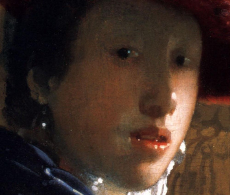 Jan Vermeer. A woman in a red hat. Fragment