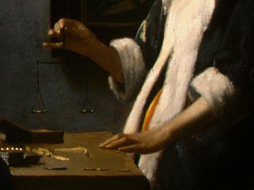 Jan Vermeer. Woman holding scales. Fragment