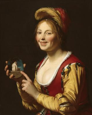 Gerard van Honthorst. Smiling Girl, a Courtesan, Holding an Obscene Image