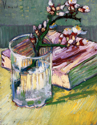 Branch of flowering almond in a vase and book