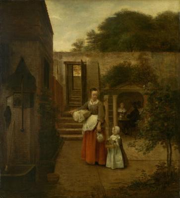 Женщина с ребенком во дворе