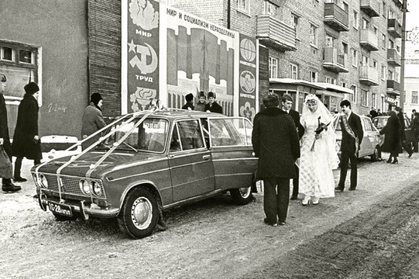 "Historical photos. Wedding on the background of the poster ""Peace and socialism are inseparable"""