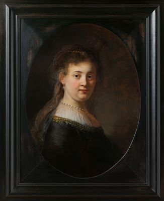 Rembrandt Harmenszoon van Rijn. Portrait of young woman in fancy costume