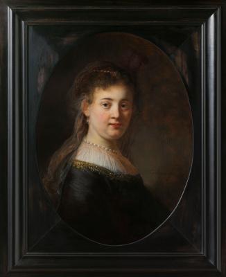 Rembrandt Harmenszoon van Rijn. Portrait of young woman in fancy costume