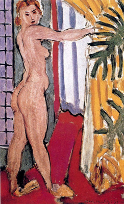 Nude standing at the open window