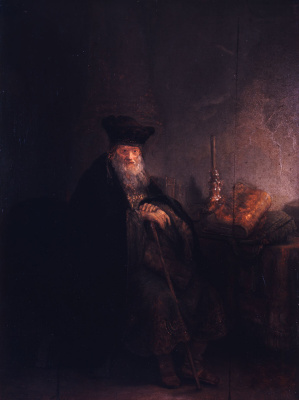 Rembrandt Harmenszoon van Rijn. Scientist at Desk with books and candle (the Old Rabbi)