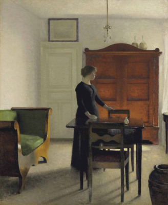 Vilhelm Hammershøi. Interior. Ida at the table in the living room