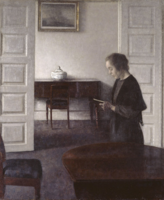 Vilhelm Hammershøi. Interior with a reading woman