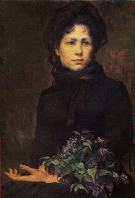 Girl with a bouquet of lilac
