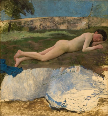 Naked young man lying on the grass