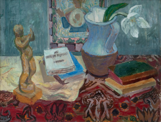 Tove Jansson. Still life with a figurine and books on a motley tablecloth