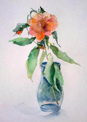 Розв в стеклянной вазе