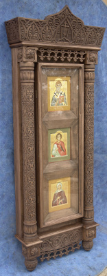 Moscow Icon Painting Workshop. The carved frame is mounted to the three icons