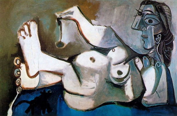 Pablo Picasso. Reclining Nude playing with a cat