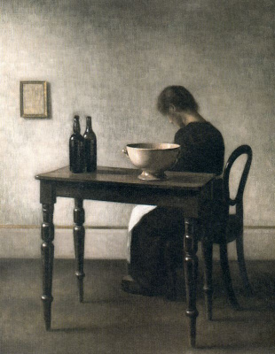 Vilhelm Hammershøi. Interior with a woman sitting at the table and a ceramic bowl