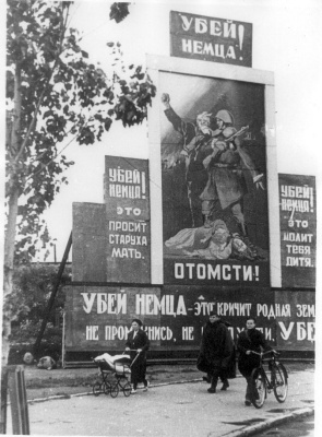 "Historical photos. Poster ""Kill the Germans!"" in military Leningrad"
