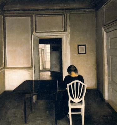 Вильгельм Хаммершёй. Женщина, сидящая на стуле
