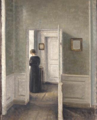 Vilhelm Hammershøi. Interior with a woman behind an open door