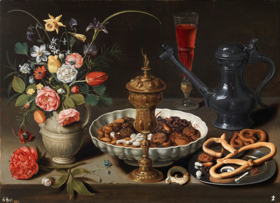 Clara Peeters. Still life with flowers, gilt Cup, dried fruit, candy, cookies, wine and pewter decanter