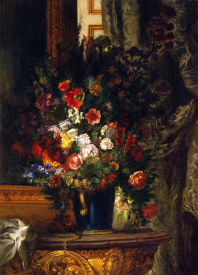 A bouquet of flowers in a vase on the console