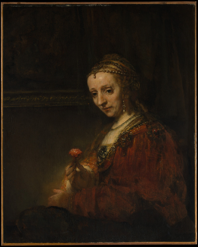 Portrait of a woman with a carnation
