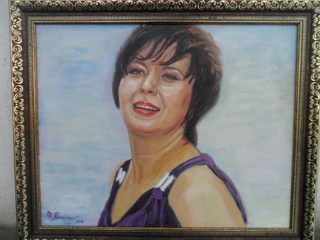 Olga Vladimirovna Mikhaylenko. Female portrait on a blue background