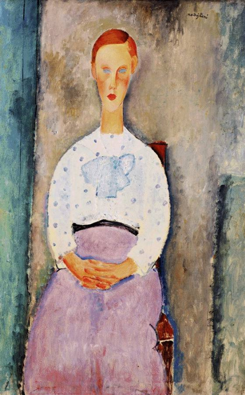 Amedeo Modigliani. Portrait of a seated girl in a blouse in polka dot