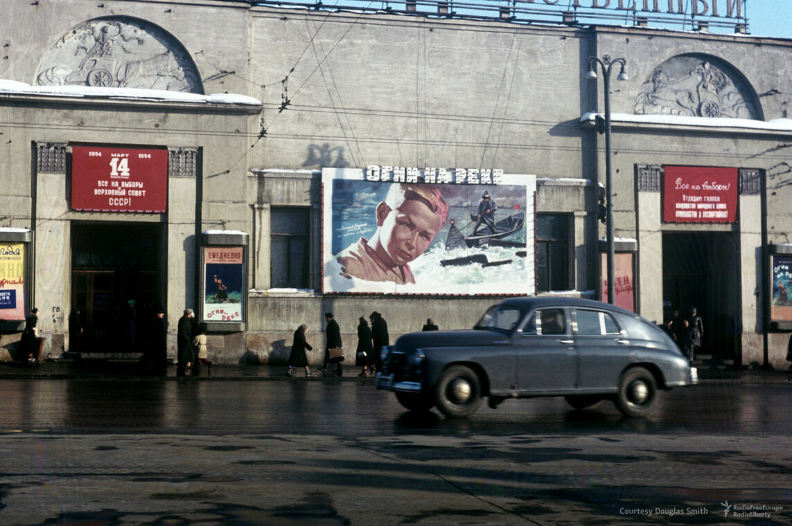 "Historical photos. Cinema on Arbat Square in Moscow. Poster of the film ""Lights on the River"" (1954) and a call to participate in elections to the Supreme Council of the USSR"