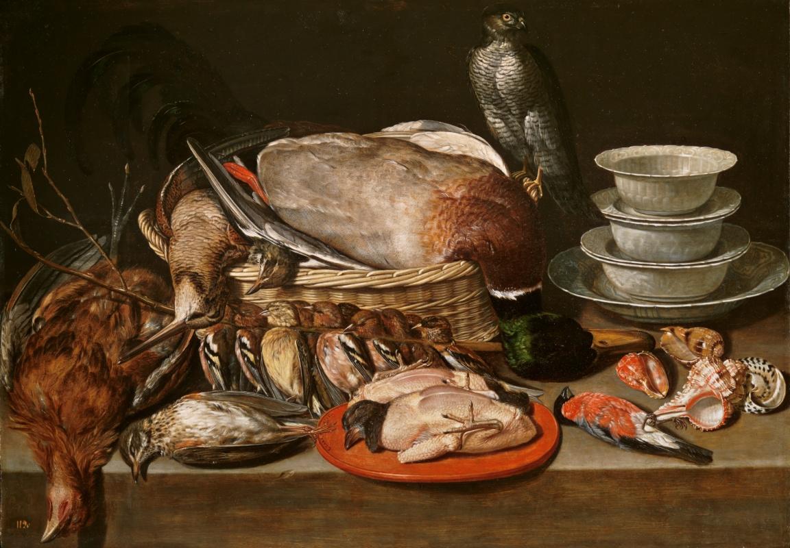 Clara Peeters. Still life with a Sparrowhawk, a bird, and porcelain sinks