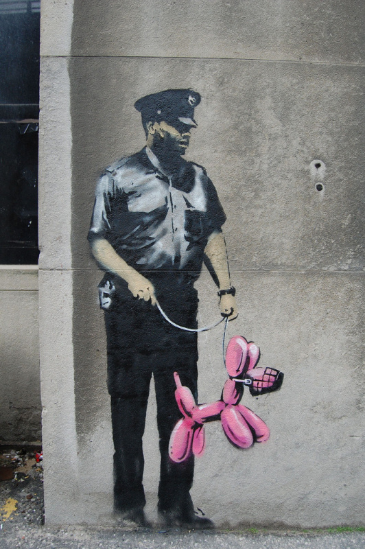 Banksy. Policeman and pink inflatable doggy