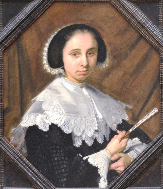 Frans Hals. Portrait of a woman facing right holding a fan