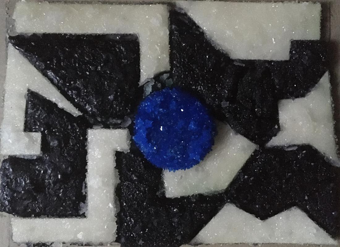 Vranin. Blue circle among black and white corners