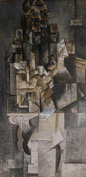 Пабло Пикассо. Мужчина с гитарой