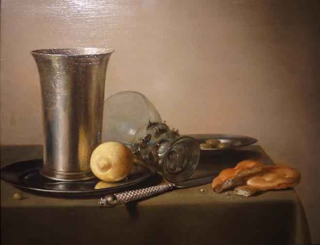Pieter Claesz. Still-life with a lemon, a knife and a fallen glass